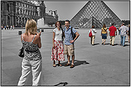 Day Tripper - Paris Louvre  is a  selective colour street photography series by photographer Paul Williams of tourists enjoying a sunny day visit to the Louvre Paris taken on 14th & 15th July 2007.