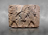 Aslantepe Hittite relief sculpted orthostat stone panel of Lion Men. Limestone, 1399-1301 BC. Anatolian Civilizations Museum, Ankara, Turkey.<br /> <br /> There are two lion-men with a sword at their waists on both sides of the tree of life. The figure on the right holds a sickle in his left hand resting on his shoulder and a symbol his right hand. The figure on the left carries a double-faced ax in his right hand. <br /> <br /> Against a grey art background. <br /> <br /> If you prefer to buy from our ALAMY STOCK LIBRARY page at https://www.alamy.com/portfolio/paul-williams-funkystock/hittite-art-antiquities.html . Type - Aslantepe - in LOWER SEARCH WITHIN GALLERY box. Refine search by adding background colour, place, museum etc.<br /> <br /> Visit our HITTITE PHOTO COLLECTIONS for more photos to download or buy as wall art prints https://funkystock.photoshelter.com/gallery-collection/The-Hittites-Art-Artefacts-Antiquities-Historic-Sites-Pictures-Images-of/C0000NUBSMhSc3Oo