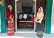 Women waiting for the church attendees at the Sunday church service in Lungleng, Mizoram, India
