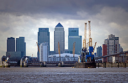 © Licensed to London News Pictures. 19/01/2012. London, UK. A view of the London Skyline from Arsenal Woolwhich Pier, featuring Canary Wharf, the Gherkin, the O2 arena and the Thames barrier. Photo credit : Ben Cawthra/LNP