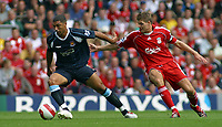 Photo: Paul Thomas.<br /> Liverpool v West Ham United. The Barclays Premiership. 26/08/2006.<br /> <br /> Hayden Mullins (L) of West Ham is chased by Steven Garrard.