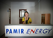 "Receptionist at Pamir Energy. Photo shoot of facilities and personel of ""Pamir Energy"", the biggest energy company in Khorog town, providing electricity (hydroelectricity) to the whole region.<br /> <br /> The town of Khorog (2200m), is the capital of the Gorno-Badakhshan Autonomous Province (GBAO) in Tajikistan. It is situated in the Pamir Mountains (ancient Mount Imeon) at the confluence of the Gunt and Panj rivers.<br /> The city is bounded to the south and to the north by the deltas of the Shakhdara and Gunt rivers, respectively. The two rivers merge in the eastern part of the city flow through the city, dividing it almost evenly until its delta in the river Panj, also being known as Amu Darya, or in antiquity the Oxus on the border with Afghanistan. Khorog is known for its beautiful poplar trees that dominate the flora of the city.<br /> Khorog is one of the poorest areas of Tajikistan, with the charitable organization Aga Khan Foundation providing almost the only source of cash income. Most of its inhabitants are Ismaili Muslims.<br /> <br /> Tajikistan, a mountainous landlocked country in Central Asia. Afghanistan borders it to the south, Uzbekistan to the west, Kyrgyzstan to the north, and People's Republic of China to the east. Tajikistan also lies adjacent to Pakistan separated by the narrow Wakhan Corridor.<br /> Tajikistan became a republic of the Soviet Union in the 20th century, known as the Tajik Soviet Socialist Republic.<br /> It was the first of the Central Asian republic to gain independence in December 1991."