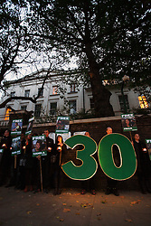 Licensed to London News Pictures. <br /> London. UK. <br /> Greenpeace activists hold a candle lit vigil outside the Russian embassy on the 30th day of the detention of the Artic 30, held in a Russian jail.<br /> Photo credit: Anna Branthwaite/LNP