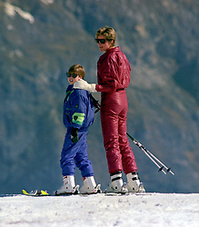 The Princess of Wales puts her arm around her eldest son, Prince William, as they wait for other members of their party to catch up during their skiing holiday in Lech, Austria.