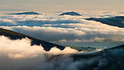 Had no idea that a huge sea of cloud would be building as I summited Garnedd Elidir, but it was such an incredible surprise benefit of this last minute evening walk into the hills. <br />