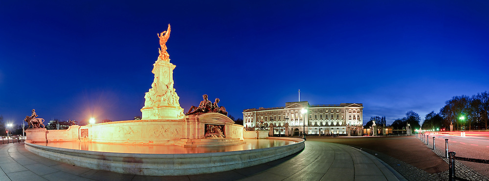 Buckingham Palace at night. East front. The Victoria Memorial is at left in the foreground.
