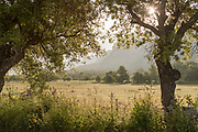 View of mountains from valley and sun on sky, Sartene, Corsica, France