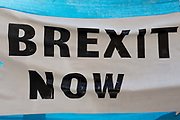 Ablue and white Brexit Now banner outside Houses of Parliament on the 29th August 2019 in London in the United Kingdom.