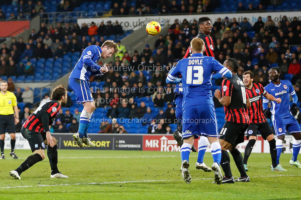 Aron Gunnarsson of Cardiff City heads narrowly wide of goal.<br /> Skybet football league championship match, Cardiff City v Brighton & Hove Albion at the Cardiff city Stadium in Cardiff, South Wales on Tuesday 10th Feb 2015.<br /> pic by Mark Hawkins, Andrew Orchard sports photography.