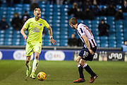 Peterborough United forward Marcus Maddison (11), Millwall midfielder Shane Ferguson (18) during the EFL Sky Bet League 1 match between Millwall and Peterborough United at The Den, London, England on 28 February 2017. Photo by Sebastian Frej.
