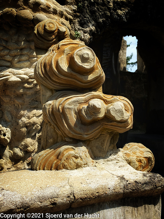 Hauterives, France, home to Ferdinand Cheval's self-made Palais idéal. This is the stone he fell over.