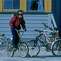 SPITSBERGEN, Norway, Longyearbyen child rides his bicycle home from school.