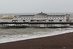© Licensed to London News Pictures. 26/01/2016. Brighton, UK. An empty beach as Brighton seafront as the remains of Storm Jonas reach the UK from the USA. Photo credit: Hugo Michiels/LNP
