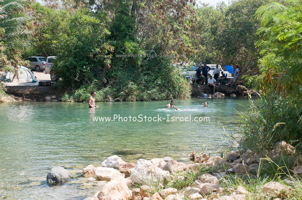 Israel, Jezreel Valley, Harod river, people swimming in a secluded natural spring pool