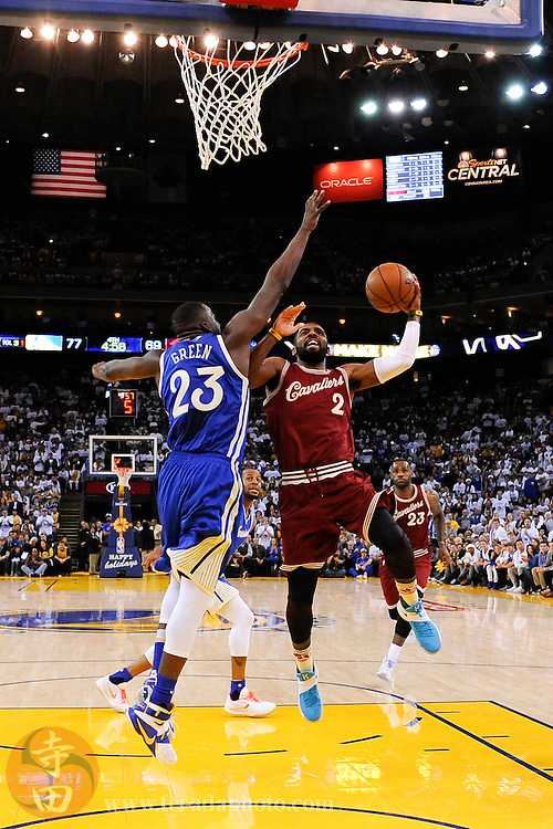 December 25, 2015; Oakland, CA, USA; Cleveland Cavaliers guard Kyrie Irving (2) shoots the basketball against Golden State Warriors forward Draymond Green (23) during the fourth quarter in a NBA basketball game on Christmas at Oracle Arena. The Warriors defeated the Cavaliers 89-83.
