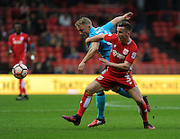 Fleetwood Town's Kyle Dempsey vies for possession with Bristol City's Joe Bryan<br /> <br /> Photographer Ashley Crowden/CameraSport<br /> <br /> Emirates FA Cup Third Round - Bristol City v Fleetwood Town - Saturday 7th January 2017 - Ashton Gate - Bristol<br />  <br /> World Copyright © 2017 CameraSport. All rights reserved. 43 Linden Ave. Countesthorpe. Leicester. England. LE8 5PG - Tel: +44 (0) 116 277 4147 - admin@camerasport.com - www.camerasport.com
