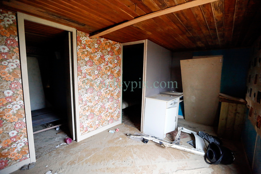 30 June 2020. South of Calais, France.<br /> Smuggler's Paradise. Interior of a seemingly deserted shack hidden in the sand dunes of a beach south of Calais where local police claim migrants often attempt the treacherous crossing to Great Britain. The shack appear to have been recently used and contains 2 steel framed beds and another bed with a stinking mattress. The location is reasonably remote and backs onto farmland. A gravel access road makes this a prime location for ruthless criminal gangs to drop migrants paying as much as €5,000 for a ticket on an inflatable dinghy with a small outboard motor and less for surfboards and inflatable kayaks. Local police claim it is from here and other beaches in the region that migrants often set out to make desperate and dangerous attempts to cross one of the busiest shipping lanes in the world. Migrants are crossing the English Channel (La Manche) by boat, kayak, surf board and even inflatable paddling pools as numbers seeking asylum in the UK continue to rise. <br /> Photo©; Charlie Varley/varleypix.com