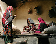 Wakhi women doing carpet with sheep wool.  The traditional life of the Wakhi people, in the Wakhan corridor, amongst the Pamir mountains.