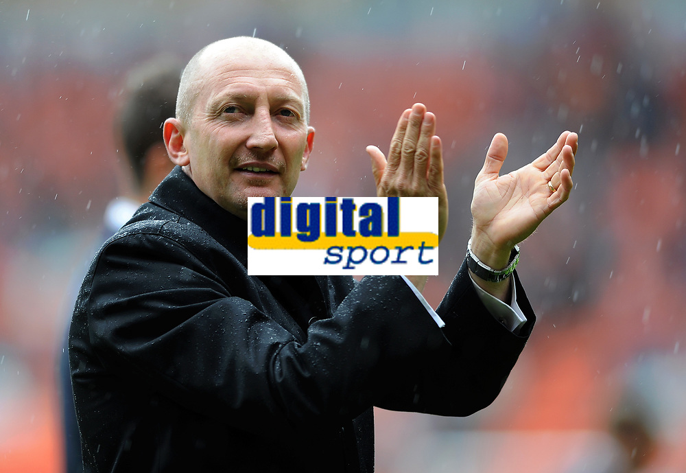 Football - Premier League - Blackpool vs. Bolton Wanderers<br /> Blackpool's Manager Ian Holloway applauds the home fans following the game at Bloomfield Road, Blackpool