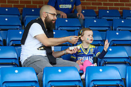 Young AFC Wimbledon fan waving during the EFL Sky Bet League 1 match between AFC Wimbledon and Accrington Stanley at the Cherry Red Records Stadium, Kingston, England on 17 August 2019.