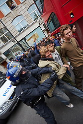 © Licensed to London News Pictures.  11/06/2013. LONDON, UK. Protesters clash with police officers during an anti G8 protest in London ahead of the start of the conference in Northern Ireland. Photo credit: Cliff Hide/LNP