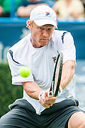 Russia's Dmitry Tursunov hits a return to USA's John Isner during their men's semifinals singles match at the Citi Open ATP tennis tournament in Washington, DC, USA, 3 Aug 2013.  Tursunov won the first set 7-6 before play was suspended due to rain in the second set.