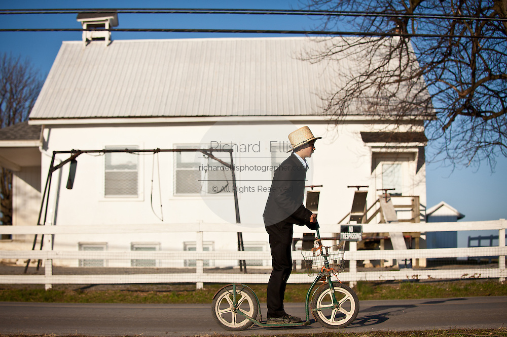 Amish boy rides a push scooter in Gordonville, PA.