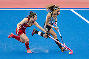 Great Britain's Laura Unsworth tackles Carla Rebecchi of Argentina. Great Britain v Argentina  - Hockey Champions Trophy, Lee Valley Hockey & Tennis Centre, London, UK on 18 June 2016. Photo: Simon Parker