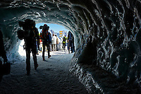 Hikers walking through the Aiguille du Midi Ice Tunnel, Chamonix, France