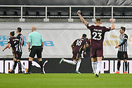 GOAL 0-1. Leeds United forward Raphinha (18) scores a goal and celebrates to make the score 0-1 during the Premier League match between Newcastle United and Leeds United at St. James's Park, Newcastle, England on 26 January 2021.