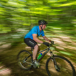 A man rides his mountain bike on a single track trail on Mount Ascutney in West Windsor, Vermont.