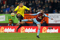Watford's Troy Deeney (left) and Burnley's Steven Defour battle for the ball during the Premier League match at Turf Moor, Burnley.