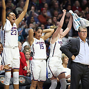 UNCASVILLE, CONNECTICUT- DECEMBER 19:  Head coach Geno Auriemma of the UConn Huskies on the sideline while recording his 1000th win as head coach of the team as the bench of Azura Stevens #23 of the Connecticut Huskies, Gabby Williams #15 of the Connecticut Huskies and Katie Lou Samuelson #33 of the Connecticut Huskies celebrate a three point basket during the Naismith Basketball Hall of Fame Holiday Showcase game between the UConn Huskies Vs Oklahoma Sooners, NCAA Women's Basketball game at the Mohegan Sun Arena, Uncasville, Connecticut. December 19, 2017 (Photo by Tim Clayton/Corbis via Getty Images)