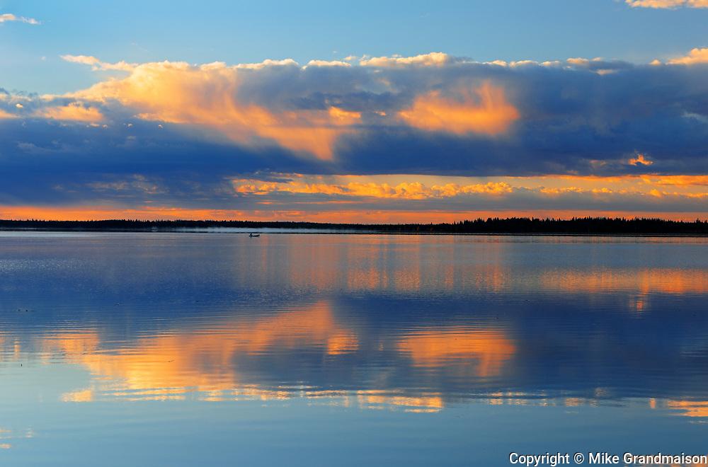 Sunrise reflection on Namekus Lake<br />Prince Albert National Park<br />Saskatchewan<br />Canada
