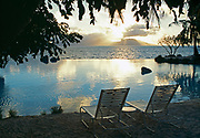 View of Moorea at sunset from Tahiti beach with beach chairs
