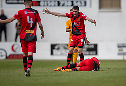 Annan Athletic's Ross Ferguson injured in a tackle by Livingston Ricki Lamie, who is sent off. Livingston 1 v 0 Annan Athletic, Scottish League Cup Group F, played 21/7/2018 at Prestonfield, Linlithgow.