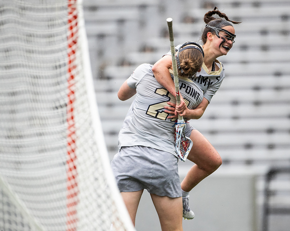 Caroline Raymond of the Army Black Knights and Olivia Carter of the Army Black Knights during the Patriot League women's lacrosse quarterfinal lacrosse game between the Army Black Knights and Lehigh Mountain Hawks at Michie Stadium on April 28, 2019 in West Point, NY.