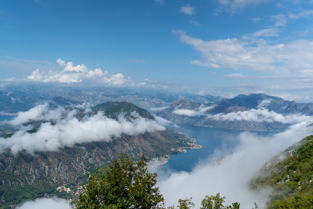 Standing on a mountain range, looking down on the clouds. Photo by Adel B. Korkor.