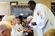 Rev. Paula Maina Waithaka offers an Annointing of the Sick to residents at The Abbington of Glenview healthcare residence on Wednesday, August 20th. Waithaka is Pastor at St. Catherine Laboure in Glenview. August 20th, 2014 l Brian J. Morowczynski-ViaPhotos<br /> <br /> For use in a single edition of Catholic New World Publications, Archdiocese of Chicago. Further use and/or distribution may be negotiated separately. <br /> <br /> Contact ViaPhotos at 708-602-0449 or email brian@viaphotos.com.