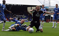 Photo: Paul Thomas.<br /> Oldham Athletic v Swansea City. Coca Cola League 1. 12/08/2006.<br /> <br /> Tom Butler of Swansea is foulled in the penalty area by Simon Charlton.