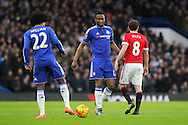 Chelsea's Willian and Chelsea's Mikel John Obi during the Barclays Premier League match between Chelsea and Manchester United at Stamford Bridge, London, England on 7 February 2016. Photo by Phil Duncan.