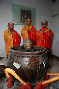 QUANZHOU, CHINA - JANUARY 10: (CHINA OUT) <br /> <br /> Monks stand by monk Fuhou\'s body which was found not rotted after putting in a vat for three and a half years at Puzhao temple on Zimao Mountain on January 10, 2016 in Quanzhou, Fujian Province of China. 94-year-old monk Fuhou died in 2012 and his body was put by the sitting position into a vat with a cover for three and a half years. Monks found that Fuhou\'s body wasn\'t rotted on an opening vat rite on January 10 at Puzhao temple on Zimao Mountain in Quanzhou. The body would be cleaned and stuck with gold to be made into a golden Buddha.<br /> ©Exclusivepix Media