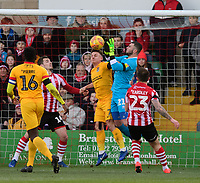 Lincoln City's Grant Smith under pressure from Northampton Town's Sam Hoskins<br /> <br /> Photographer Chris Vaughan/CameraSport<br /> <br /> The EFL Sky Bet League Two - Lincoln City v Northampton Town - Saturday 9th February 2019 - Sincil Bank - Lincoln<br /> <br /> World Copyright © 2019 CameraSport. All rights reserved. 43 Linden Ave. Countesthorpe. Leicester. England. LE8 5PG - Tel: +44 (0) 116 277 4147 - admin@camerasport.com - www.camerasport.com