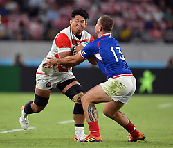 Japan's Kazuki Himeno is tackled by Russia's Vladimir Ostroushko during the Pool A match between Japan and Russia at the Tokyo Stadium, Tokyo, Japan. Picture date: Friday September 20, 2019. See PA story RUGBYU Japan. Photo credit should read: Ashley Western/PA Wire. RESTRICTIONS: Editorial use only. Strictly no commercial use or association. Still image use only. Use implies acceptance of RWC 2019 T&Cs (in particular Section 5 of RWC 2019 T&Cs) at: https://bit.ly/2knOId6