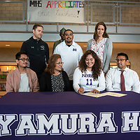 Miyamura senior Matejka Abeita signs a letter of intent to play volleyball at Lakeland University in Wisconsin surrounded by her teachers and coaches, back row left to right, Josh Dupont, Reyes Hernandez, Sarah Mortensen, and front row her family, left to right, brother Cameron Abieta, mom Merriam Abieta, and brother Damian Abieta, Tuesday, May 14 at Miymaura High School in Gallup.