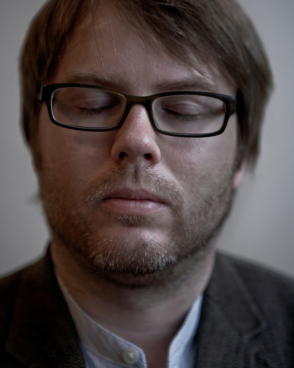 Portrait of a man in glasses with his eyes closed