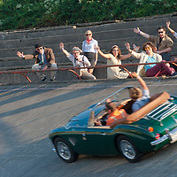 Viewers cheer for the participants of the hIstoric car race in Budapest, Hungary on September 17, 2011. ATTILA VOLGYI