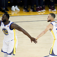OAKLAND, CA - MAY 31: Draymond Green #23 of the Golden State Warriors celebrates with Stephen Curry #30 of the Golden State Warriors in Game One of the 2018 NBA Finals won 124-114 in OT by the Golden State Warriors over the Cleveland Cavaliers at the Oracle Arena on May 31, 2018 in Oakland, California. NOTE TO USER: User expressly acknowledges and agrees that, by downloading and or using this photograph, User is consenting to the terms and conditions of the Getty Images License Agreement. Mandatory Copyright Notice: Copyright 2018 NBAE (Photo by Chris Elise/NBAE via Getty Images)