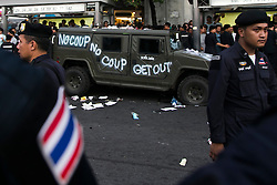 © Licensed to London News Pictures. 28/05/2014. Police surround a Military humvee which was graffitied and pelted with projectiles during a Anti-Coup protest at Victory Monument Bangkok Thailand.  Photo credit : Asanka Brendon Ratnayake/LNP