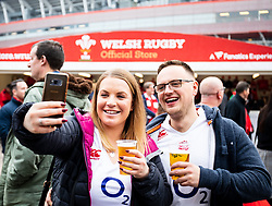 Fans take a selfie outside of the stadium<br /> <br /> Photographer Simon King/Replay Images<br /> <br /> Six Nations Round 3 - Wales v England - Saturday 23rd February 2019 - Principality Stadium - Cardiff<br /> <br /> World Copyright © Replay Images . All rights reserved. info@replayimages.co.uk - http://replayimages.co.uk
